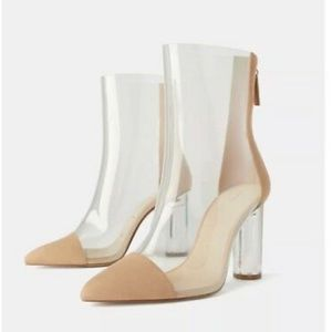 Clear ankle heeled boots